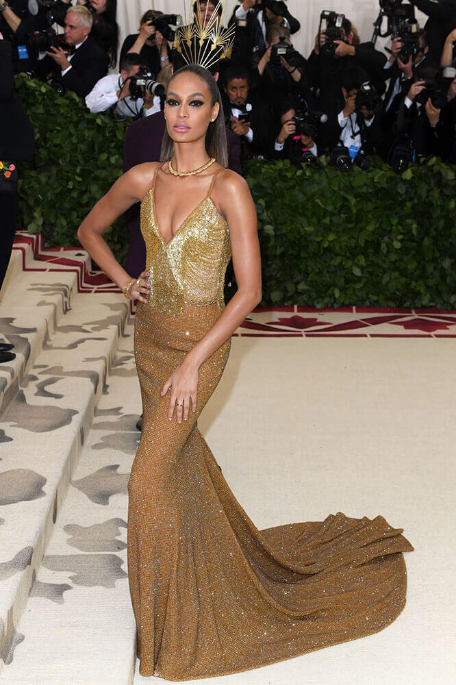 Joan Smalls in Tommy Hilfiger gown and Philip Treacy headdress