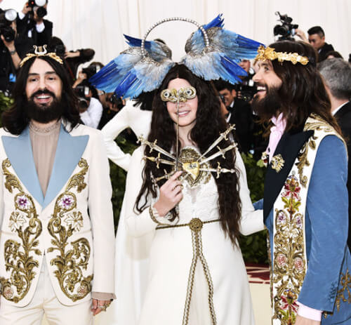 Alessandro Michele of Gucci, Lana Del Rey & Jared Leto, all in Gucci looks embroidered in gold bullion with gold accessories.